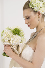 Beautiful bride looking at the bouquet