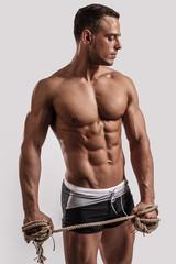 Portrait of muscular handsome guy.