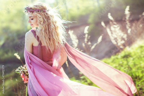 Beautiful blonde girl in pink long dress - 78412379