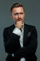 Portrait of a man in suit.