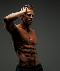 Muscular female in black shorts.