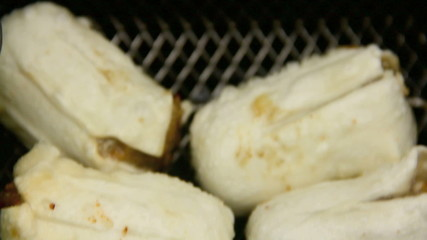 Dim sums lifted shaken than dropped back in deep fryer.
