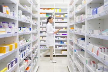 Pharmacist walking through pharmacy