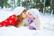 Mom and daughter lying on the snow in winter