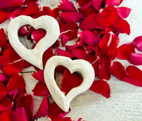 Love: white hearts and red rose petals :)