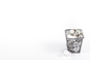 isolated wastebasket full of white waste newspaper