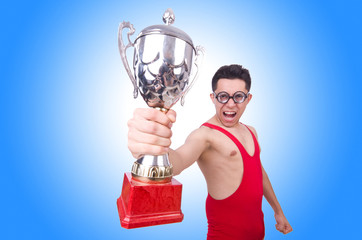 Funny wrestler with winners cup