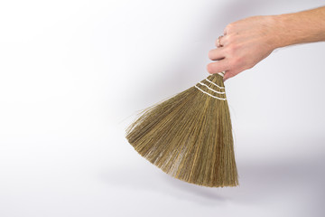 isolated broom in a man's hand