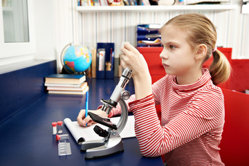 Girl examines drug for the microscope