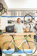 Store manager behind counter in bicycle shop