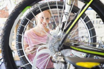 Female customer in shop choosing a bicycle