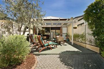 backyard cozy patio area with wicker furniture set