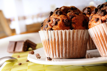 Muffins with chocolate chips on the table