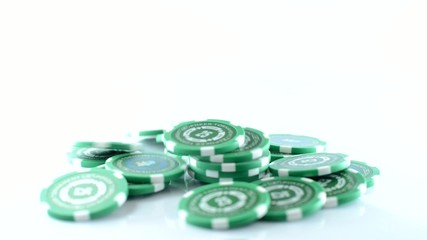 Poker chips falling, the rotation around the axis