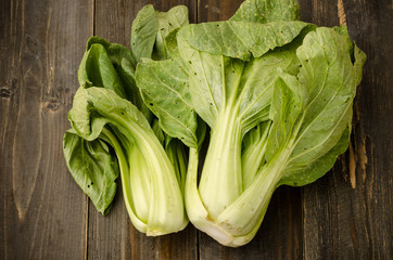 Chinese cabbage ( Bok choy) on wooden background