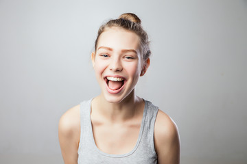 Portrait of young woman laughing and having fun.