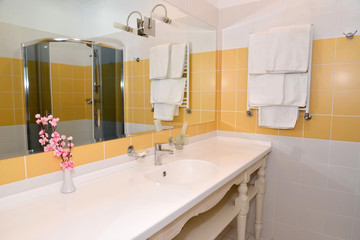Bathroom interior fragment with a big mirror