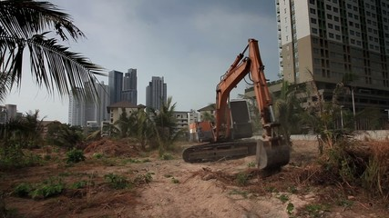 Stock Video Footage Excavator, background of a modern building