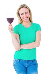 Smiling blonde holding glass of red wine