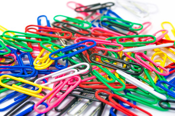 Colorful paperclips on white background isolated