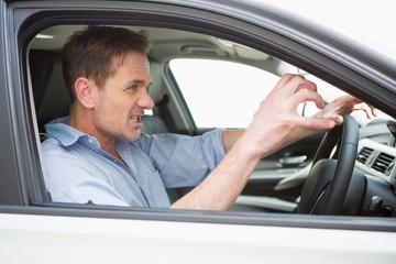 Handsome man experiencing road rage