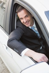Handsome businessman smiling at camera