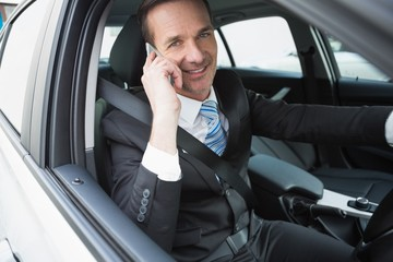 Happy businessman on the phone