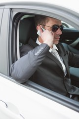 Businessman on the phone wearing sunglasses