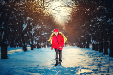 Beauty Teenager Girl Running in frosty winter Park. Outdoors. Su