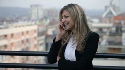 Portrait of pretty woman with cellphone,talking and smiling
