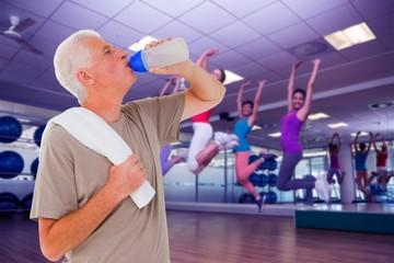 Senior man drinking from water bottle