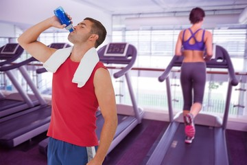 Fit man drinking water from bottle