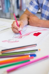 College student drawing picture with colored pencil