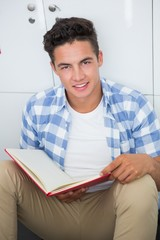 Smiling college student holding notebook