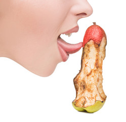 girl touching tongue to bits of pear-like dildo