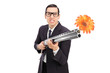 Angry businessman shooting flowers from a rifle