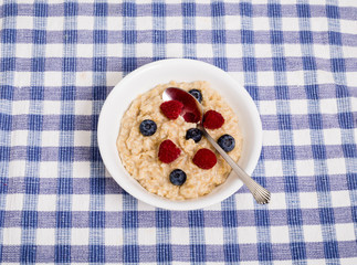 Oatmeal with Berries and Spoon