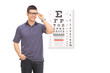 Man standing in front of an eye chart
