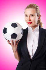 Businesswoman with football on white
