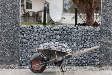 wheelbarrow full with gravel