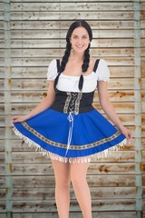 Composite image of pretty oktoberfest girl posing and smiling