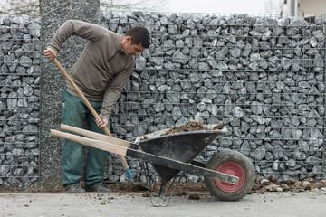 worker fill the wheel barrow