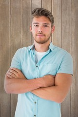 Composite image of handsome young man posing with arms crossed