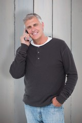Composite image of casual man on the phone