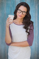 Composite image of brunette with mug