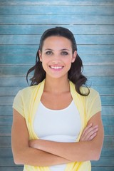 Composite image of pretty brunette smiling at camera