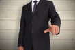 Composite image of businessman pointing