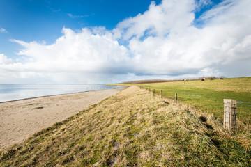 Beach and a dike along a Dutch estuary