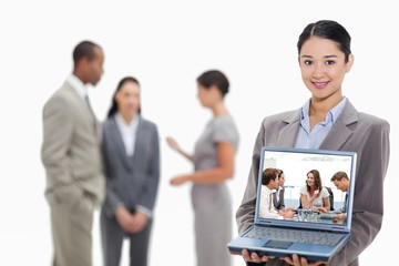 Composite image of glad businesswoman talking to her team