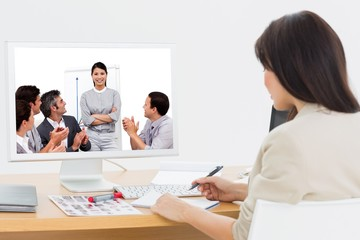 Composite image of portrait of a business team sitting together